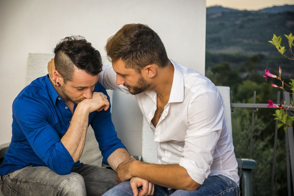 two men consoling each other after an argument concept of same-sex conflict resolution