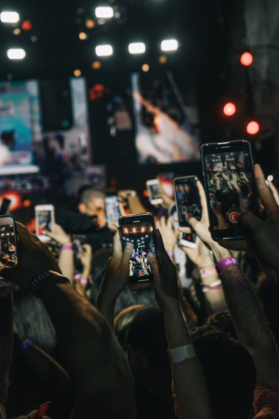 Crowd holding up cellphones at a concert