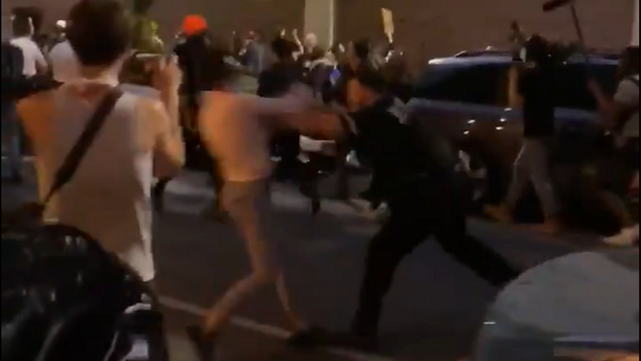 Police officer shoves women during peaceful protest in Brooklyn