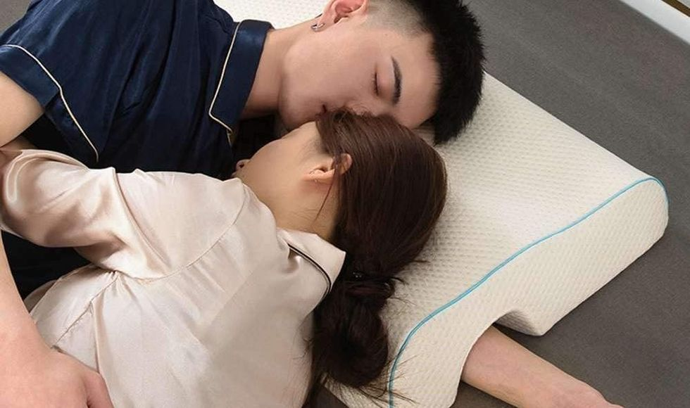 If You're Tired Of Your Arm Falling Asleep While Spooning, You Need This Cuddle Pillow