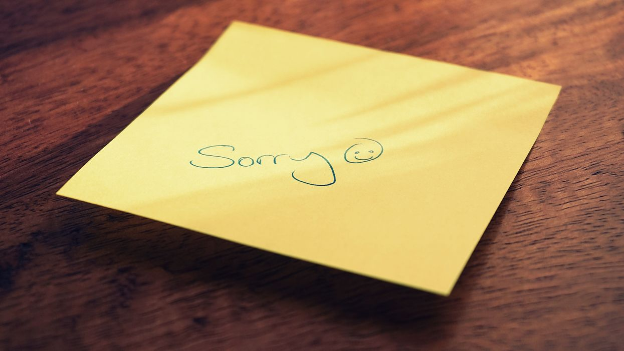 stick note with the word sorry and a smiley face