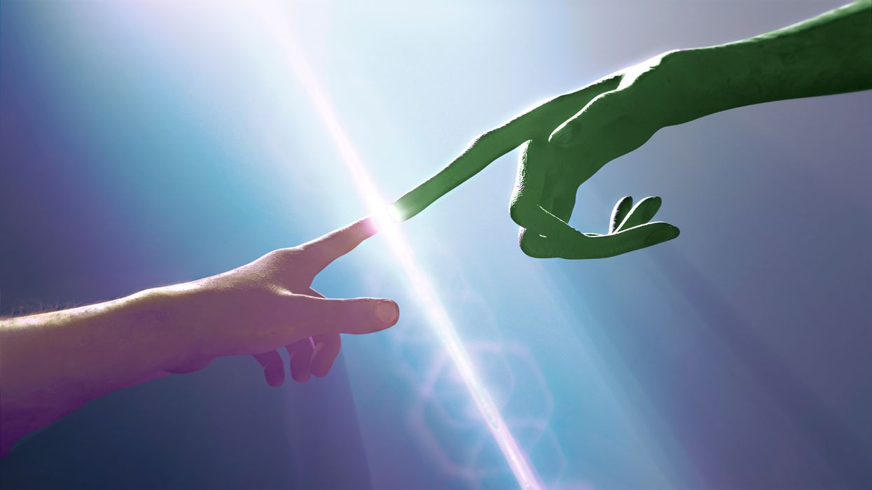 Alien and human touching fingers