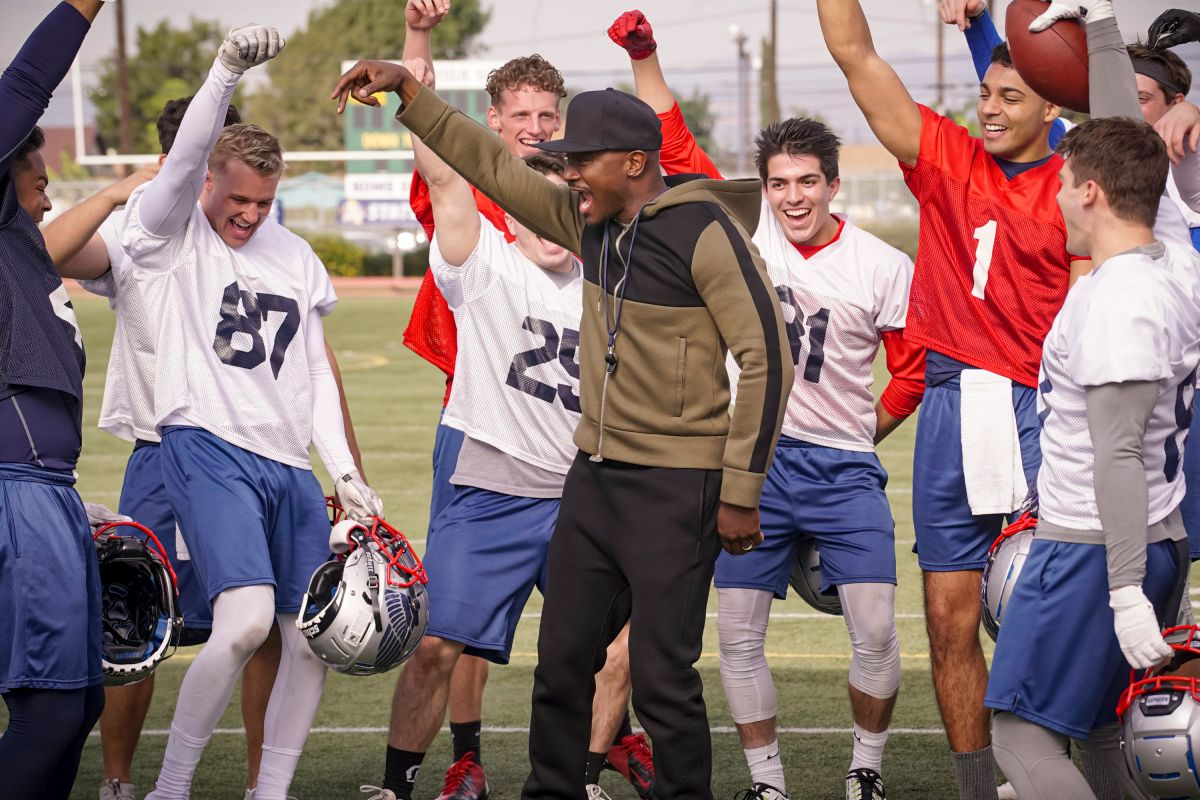 High school football players with Taye Diggs on TV show from The CW All American