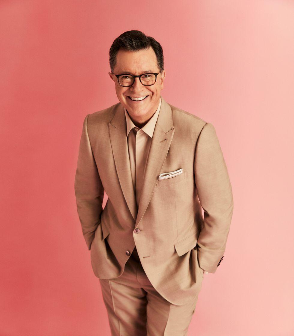Stephen Colbert in a tan suit.