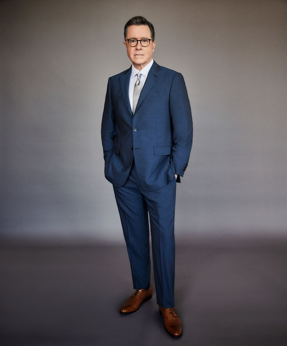 Stephen Colbert in a navy blue suit.