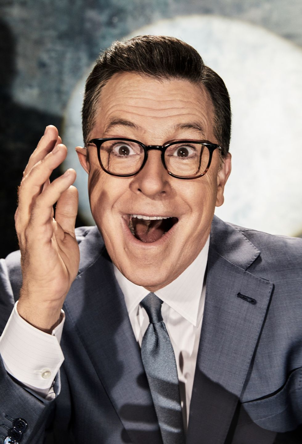 Close-up portrait of Stephen Colbert making expressive face.