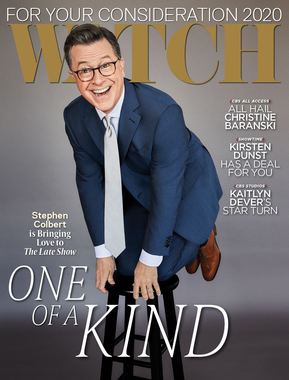 Stephen Colbert in a blue suit kneeling on a stool for a magazine cover.