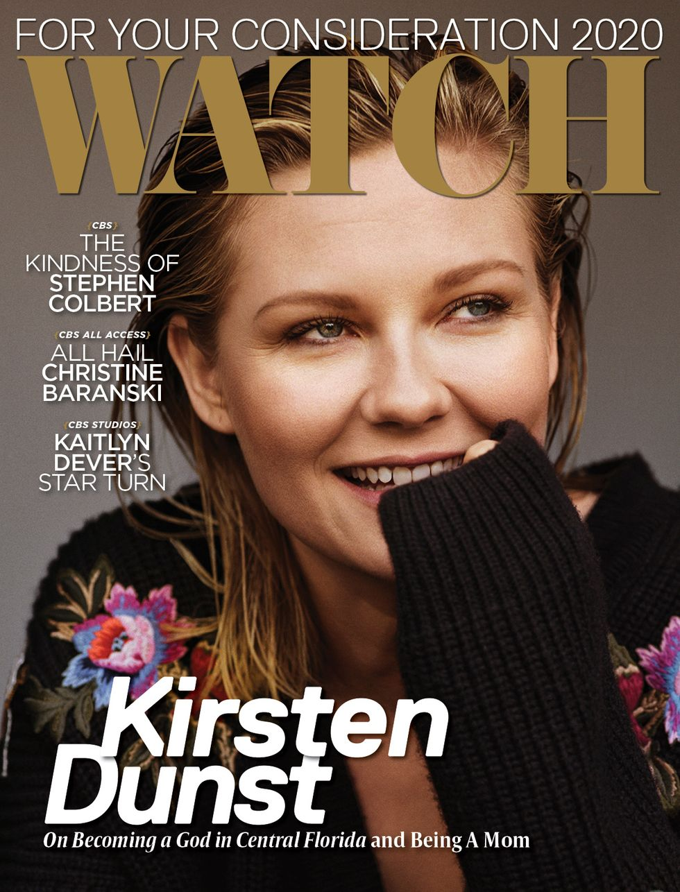 Kirsten Dunst smiling on the cover of a magazine.