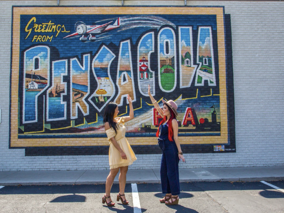 Friends in front of Pensacola Mural