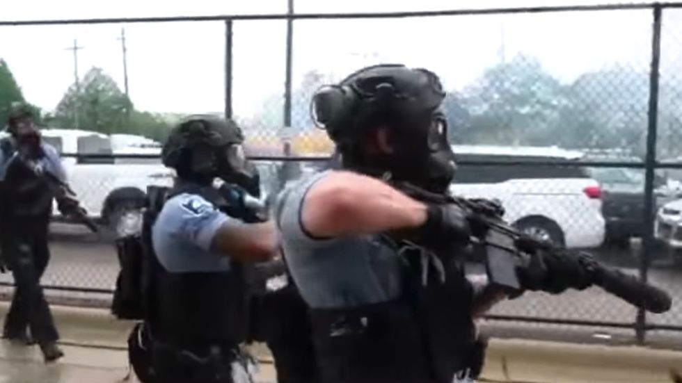 In America, The Police Only Shoot Protesters Who Can't Fire Back, Not Those Armed With Assault Rifles