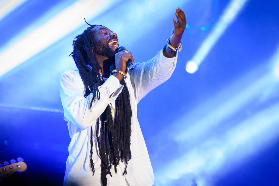 Buju Banton sings on stage.