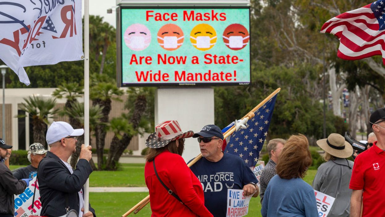 pro-police rally in front of electronic face mask sign