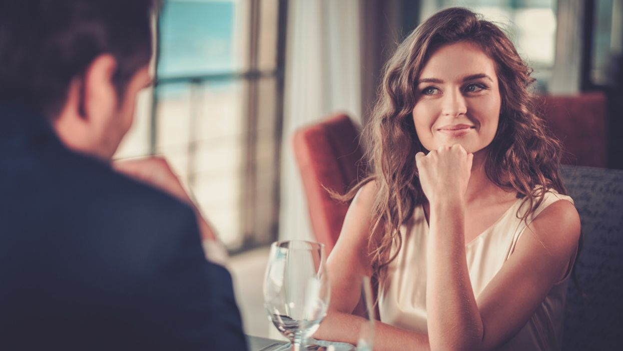 woman smiling and staring at her date