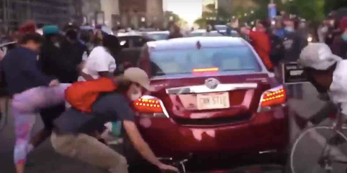 Leftists go berserk at protest, surround and smash up car — and it turns out driver has cerebral palsy
