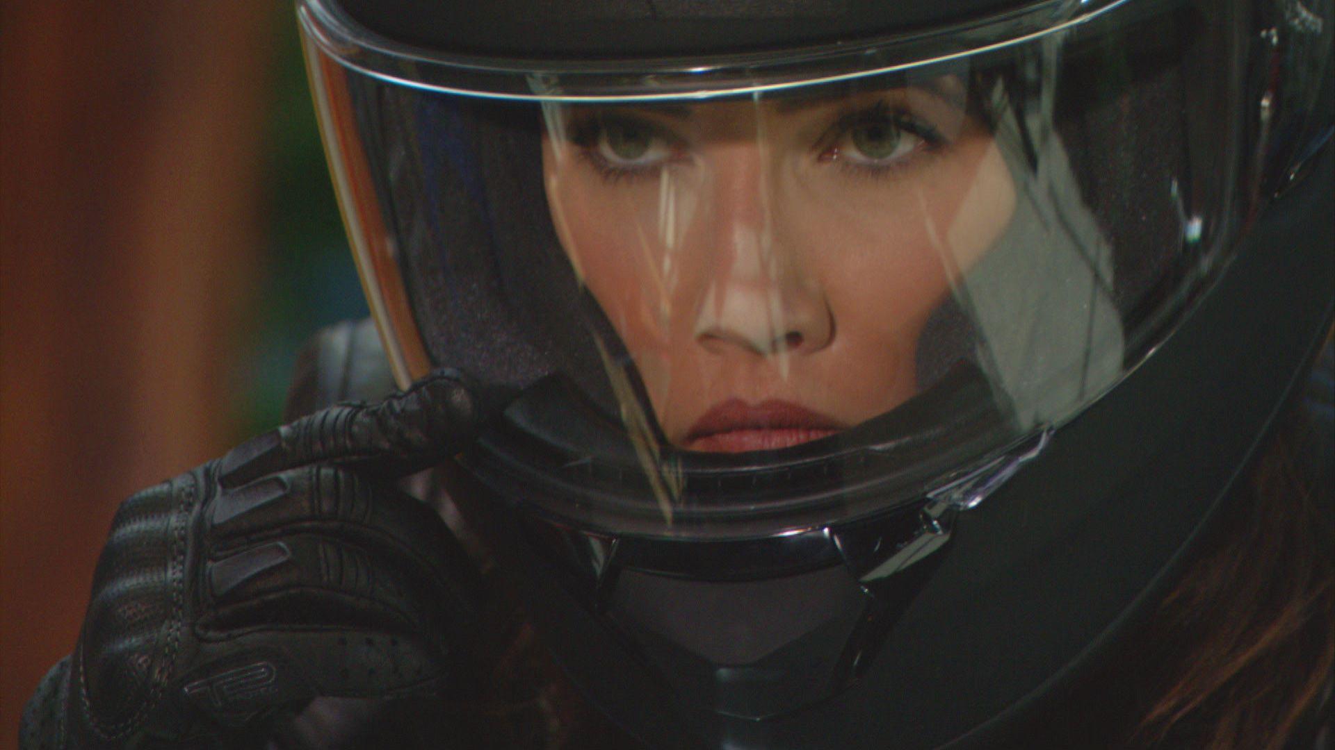 \u200bJacqueline MacInnes Wood as Steffy adjusts her black motorcycle helmet
