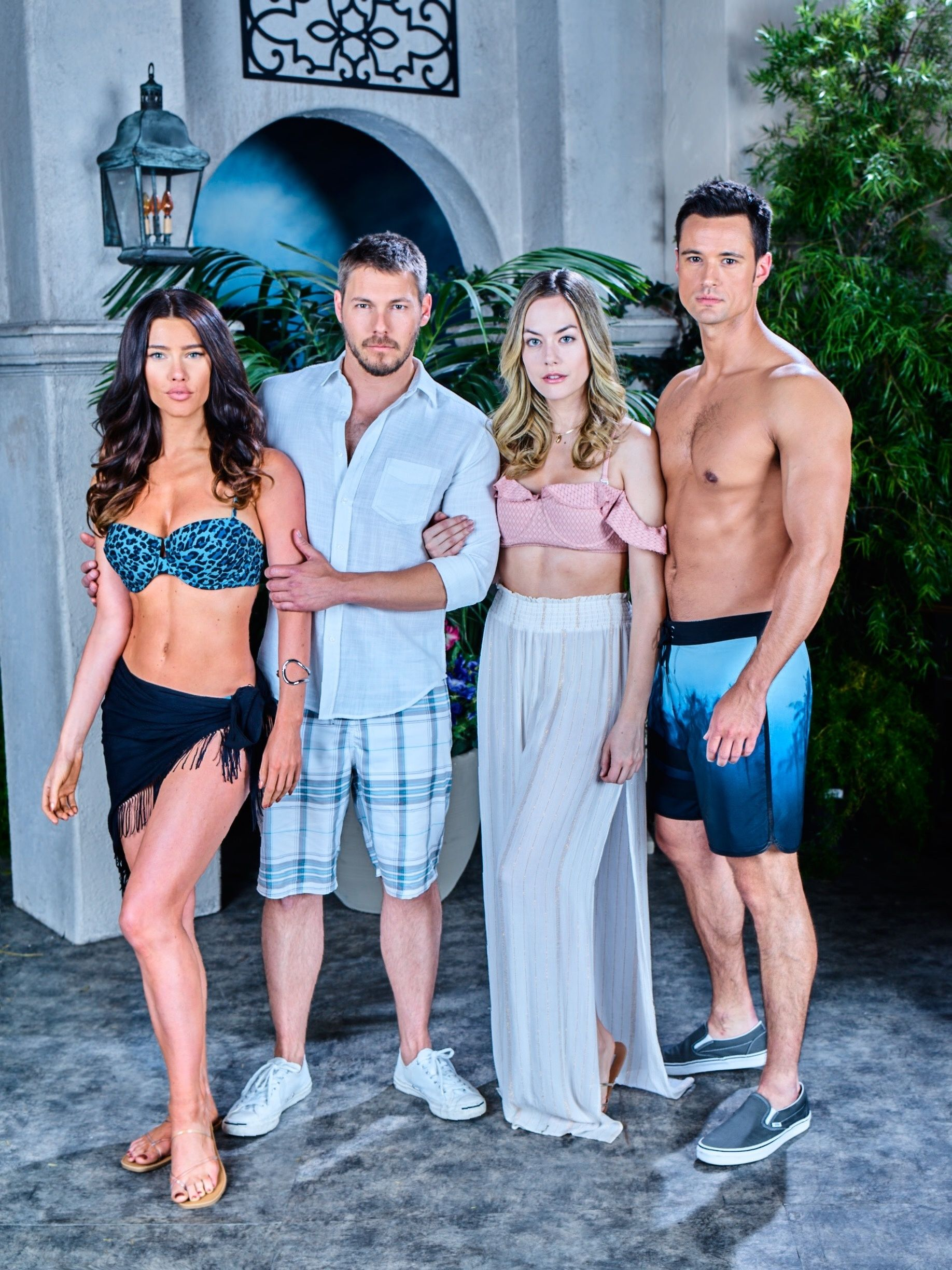 Jacqueline MacInnes Wood, Scott Clifton, Annika Noelle, and Matthew Atkinson against a backdrop of palms and an arched doorway