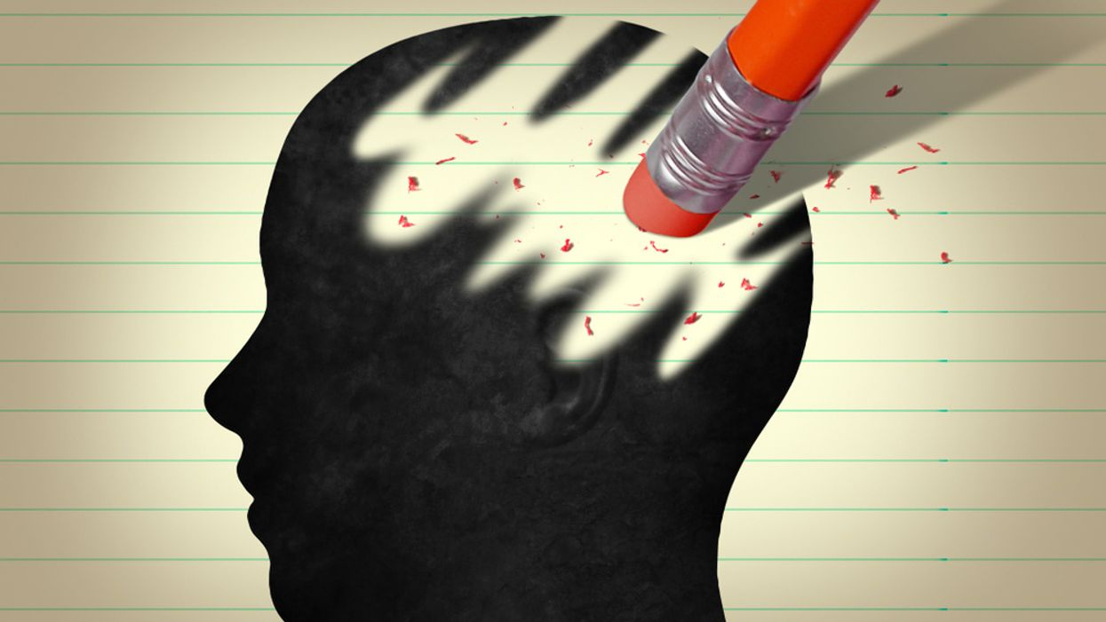 silhouette of human head on paper partially erased by pencil