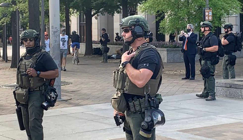 'Department of Justice' deploys rogue force of unidentified armed militia to patrol DC