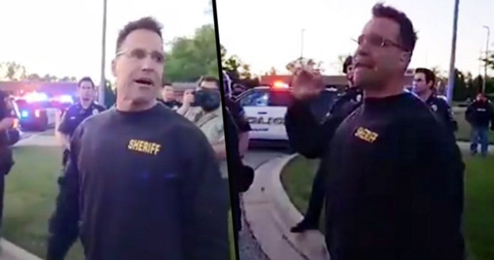 Extraordinary Moment Sheriff Puts Down Helmet and Baton and Walks With Protestors