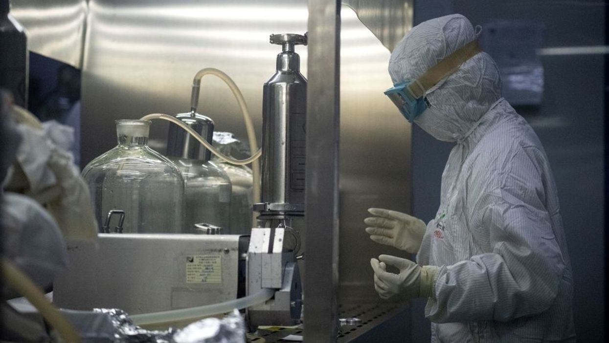 researcher wearing protective gear in lab