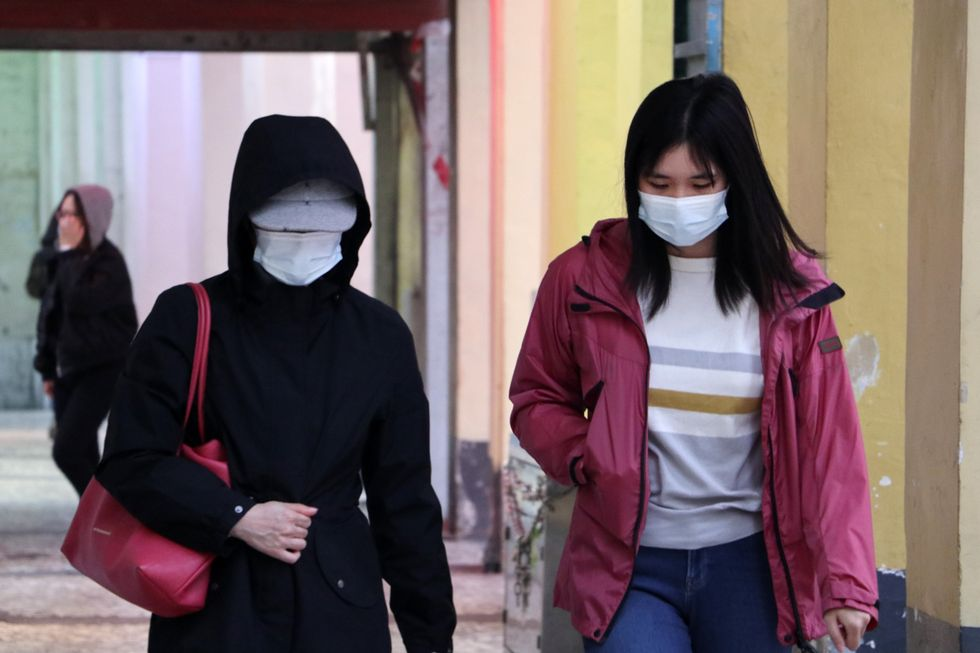 Two Asian women with masks