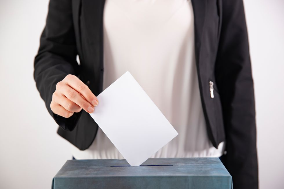 Can sending a postcard to eligible voters increase turnout?