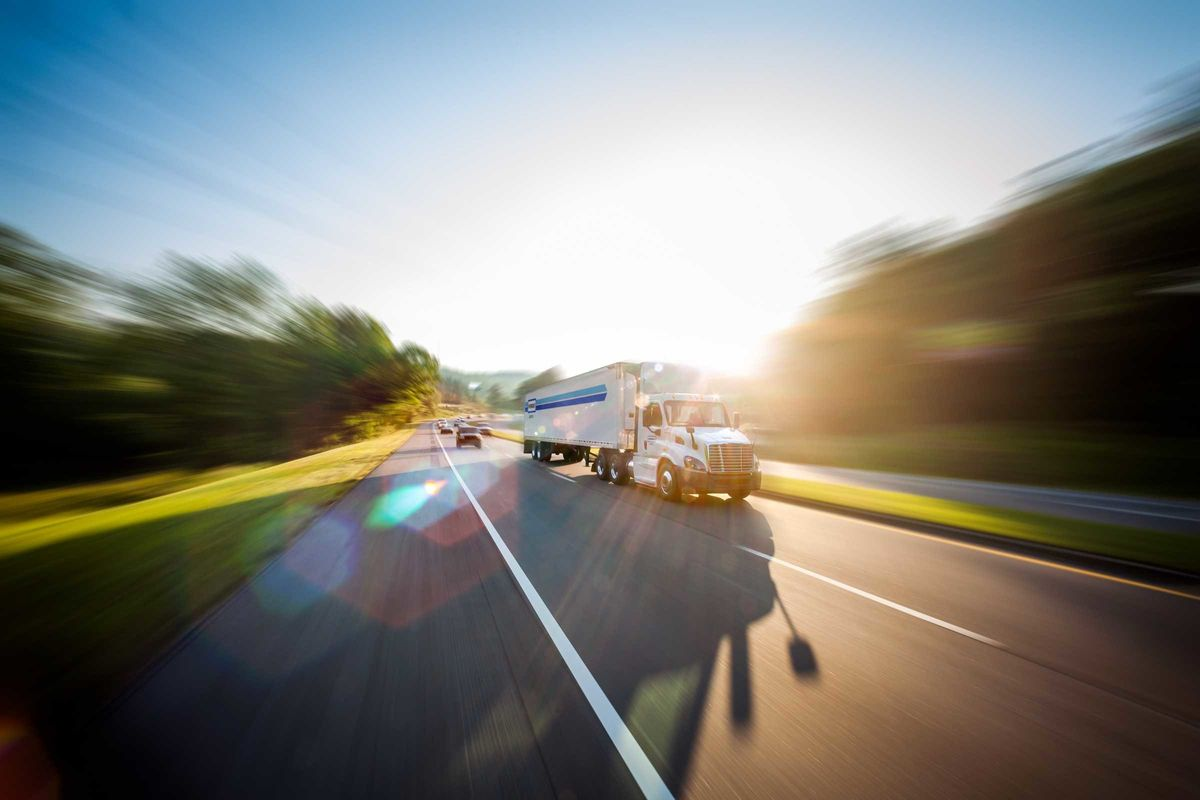 penske tractor and trailer on highway