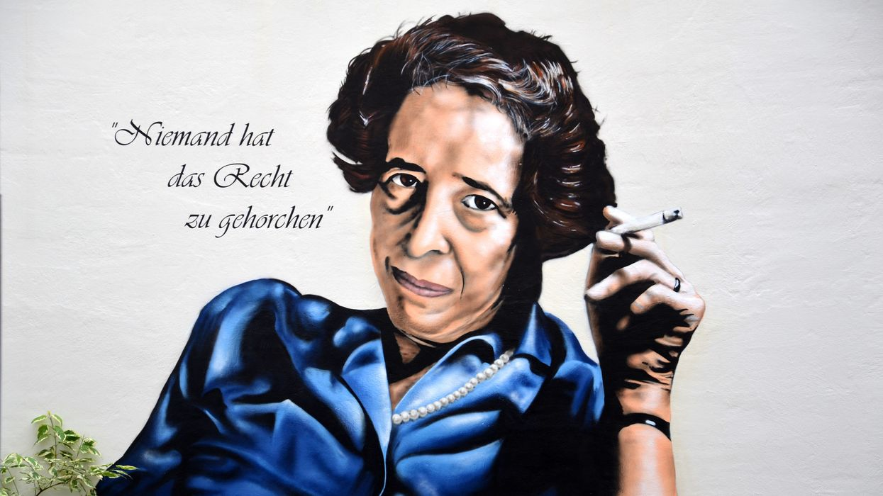 "A portrait of Hannah Arendt with a cigarette and her famous saying ""Nobody has the right to obey."""