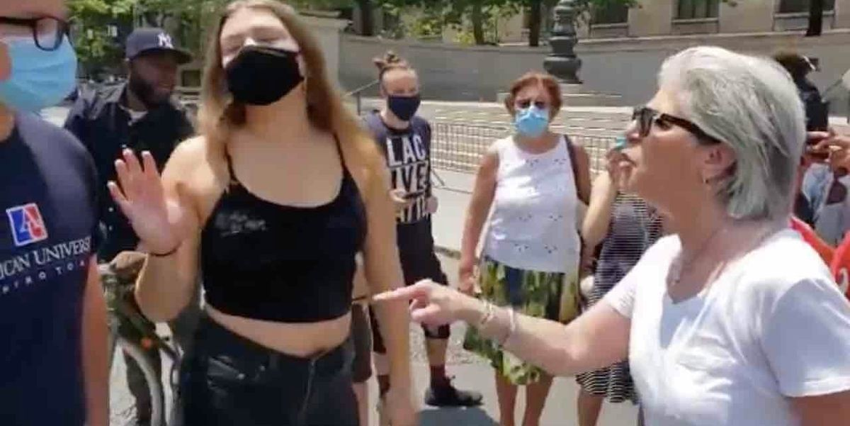 'You got something to say, little boy?': Older woman gets right back in leftist punk's face after he orders her to 'check your f***ing privilege'