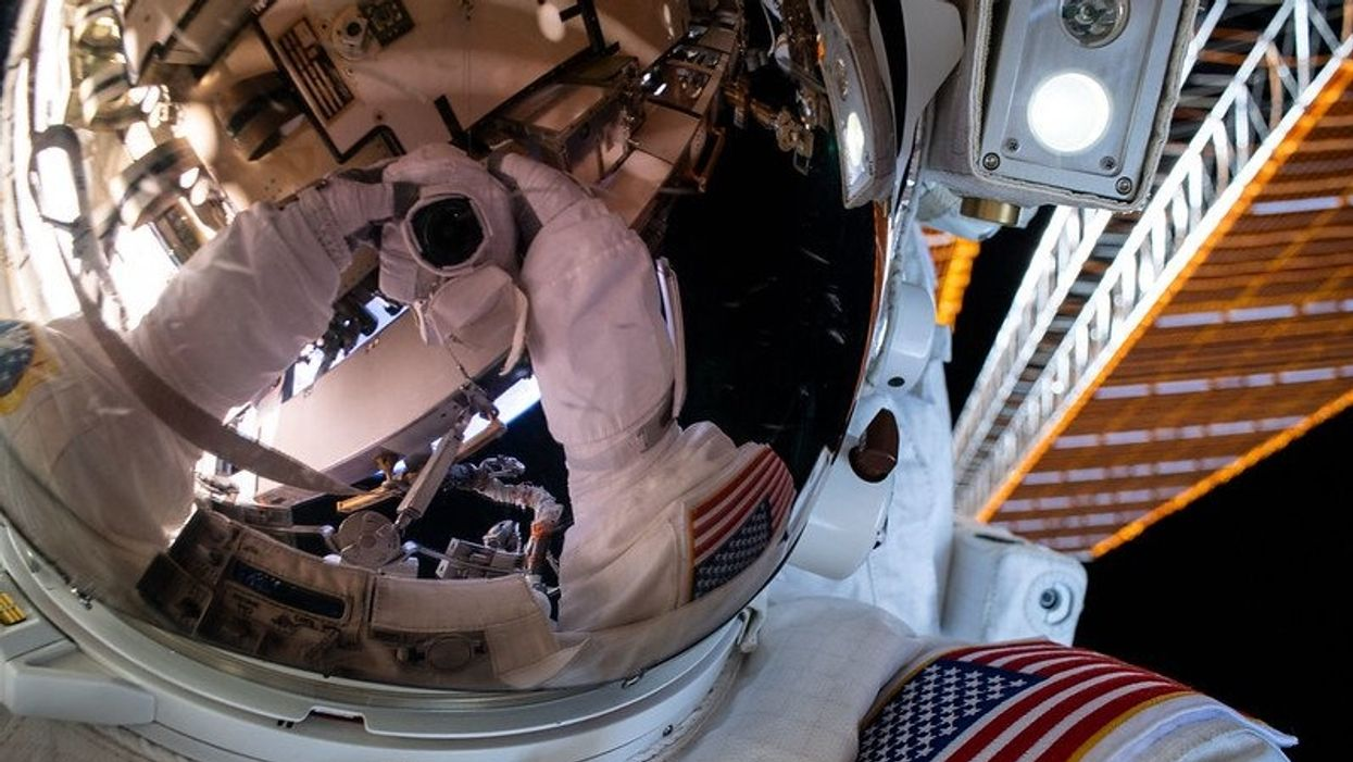 NASA astronaut during a spacewalk outside of the International Space Station