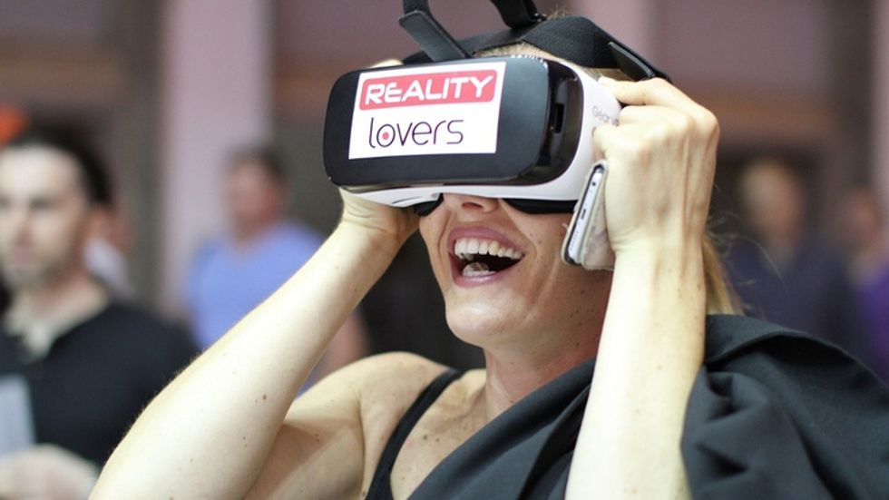 u200ba woman with a VR headset on watching VR porn