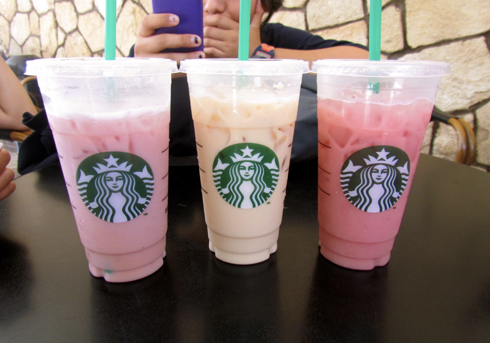 Unknown Starbucks iced drinks in a row, left to right, pink drink, tan drink, hot pink drink.