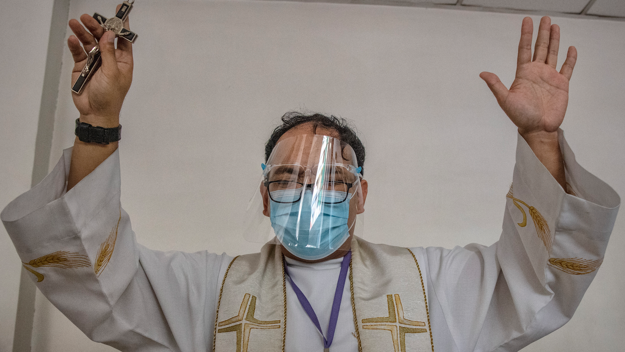 Priest wearing mask