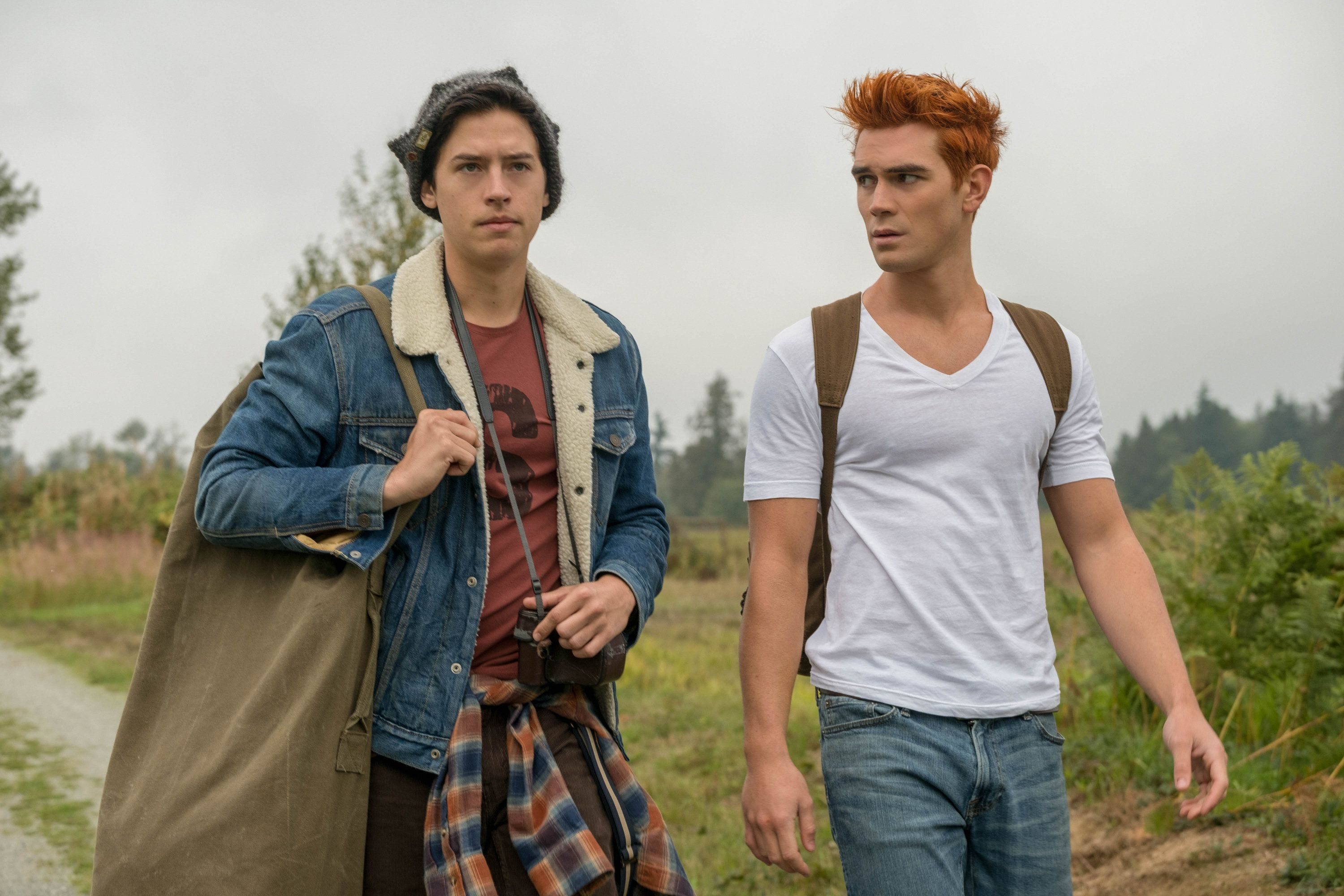 Jughead and Archie walking down a road