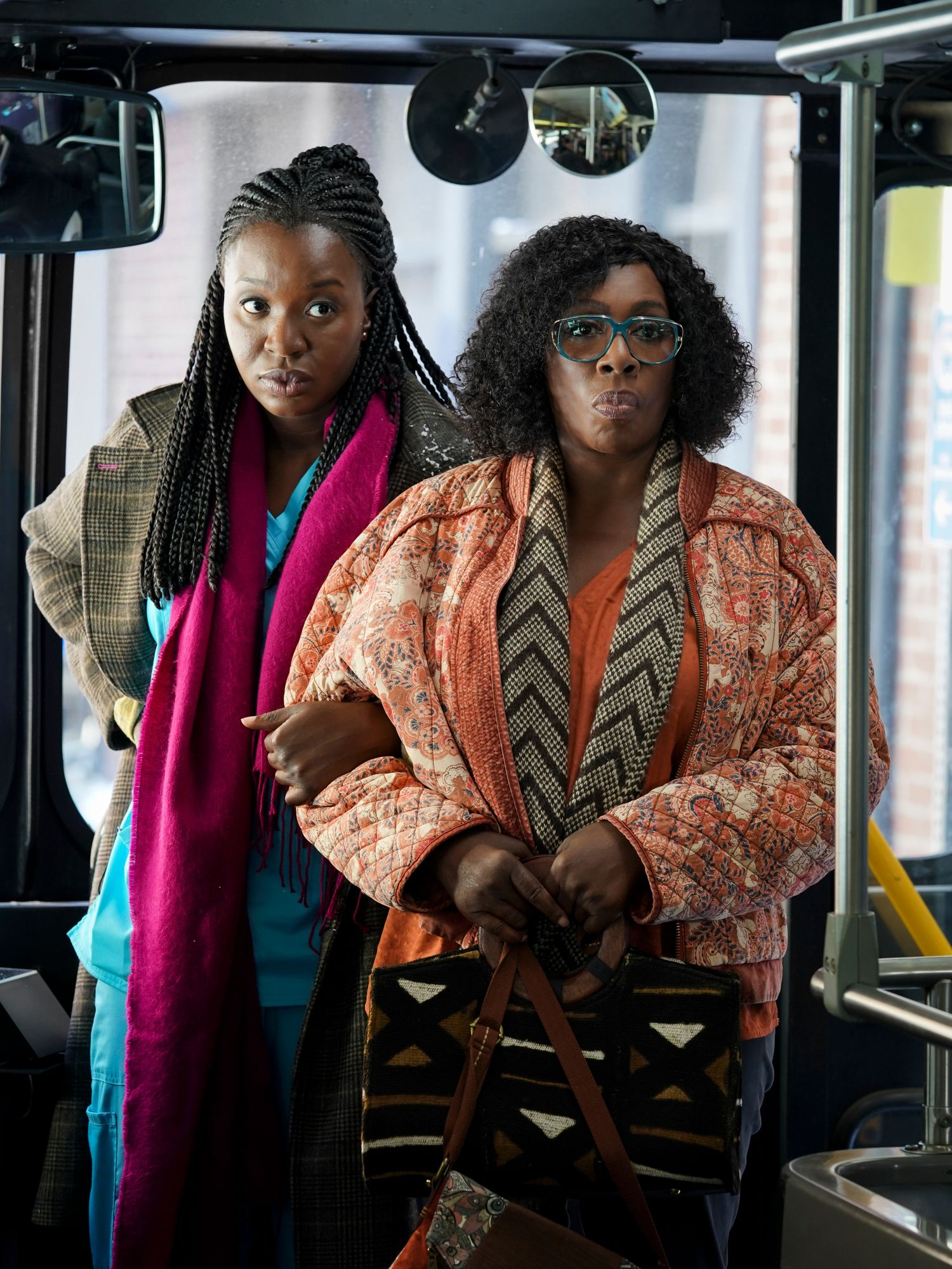 Abishola and Kemi boarding a bus