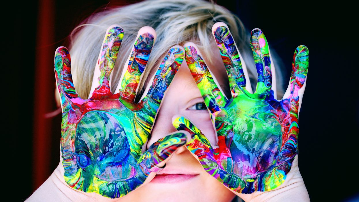 child with paint covered hands