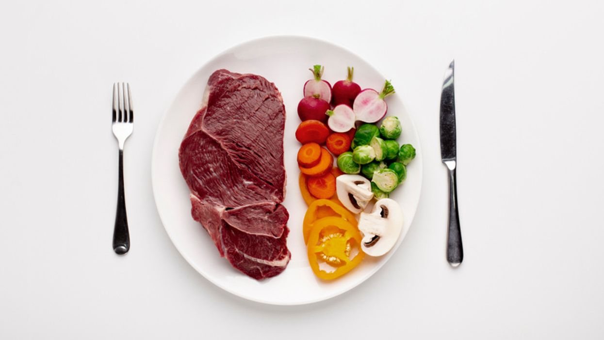 plate with white background and half meat and half vegetables