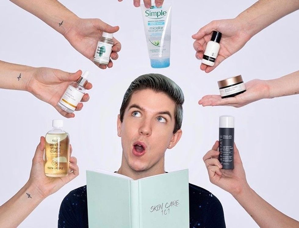 Skin care influencer Hyram surrounded by his favorite products.