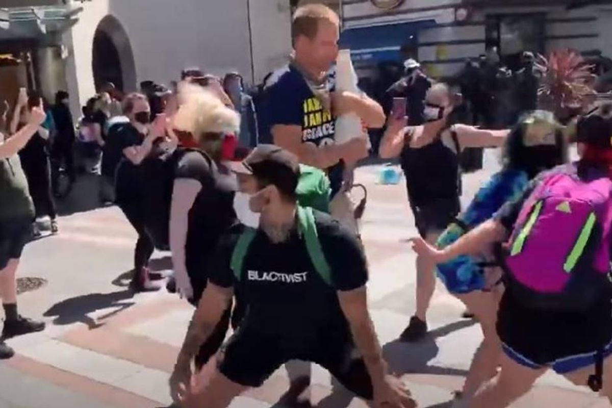 Seattle protesters show the best way to non-violently shut up a notorious street preacher