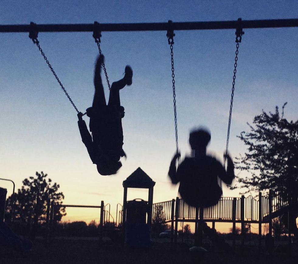 two people swinging