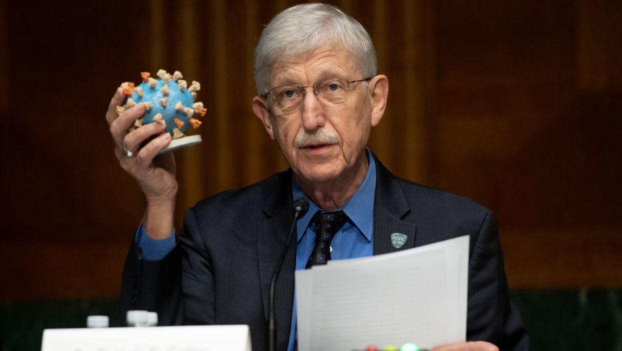 Dr. Francis Collins holding COVID-19 model