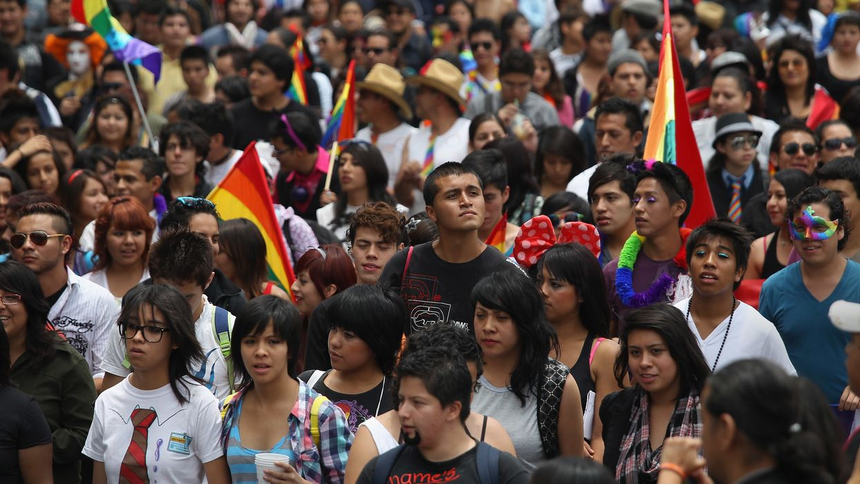 crowd in Mexico City holding Pride flags