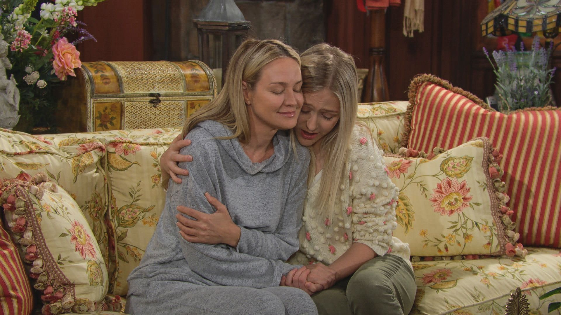 Alyvia Alyn Lind as Faith wraps comforting arm around Sharon Case as Sharon