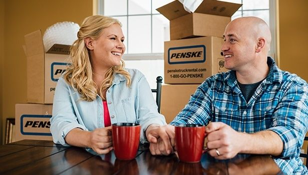 people with penske moving boxes