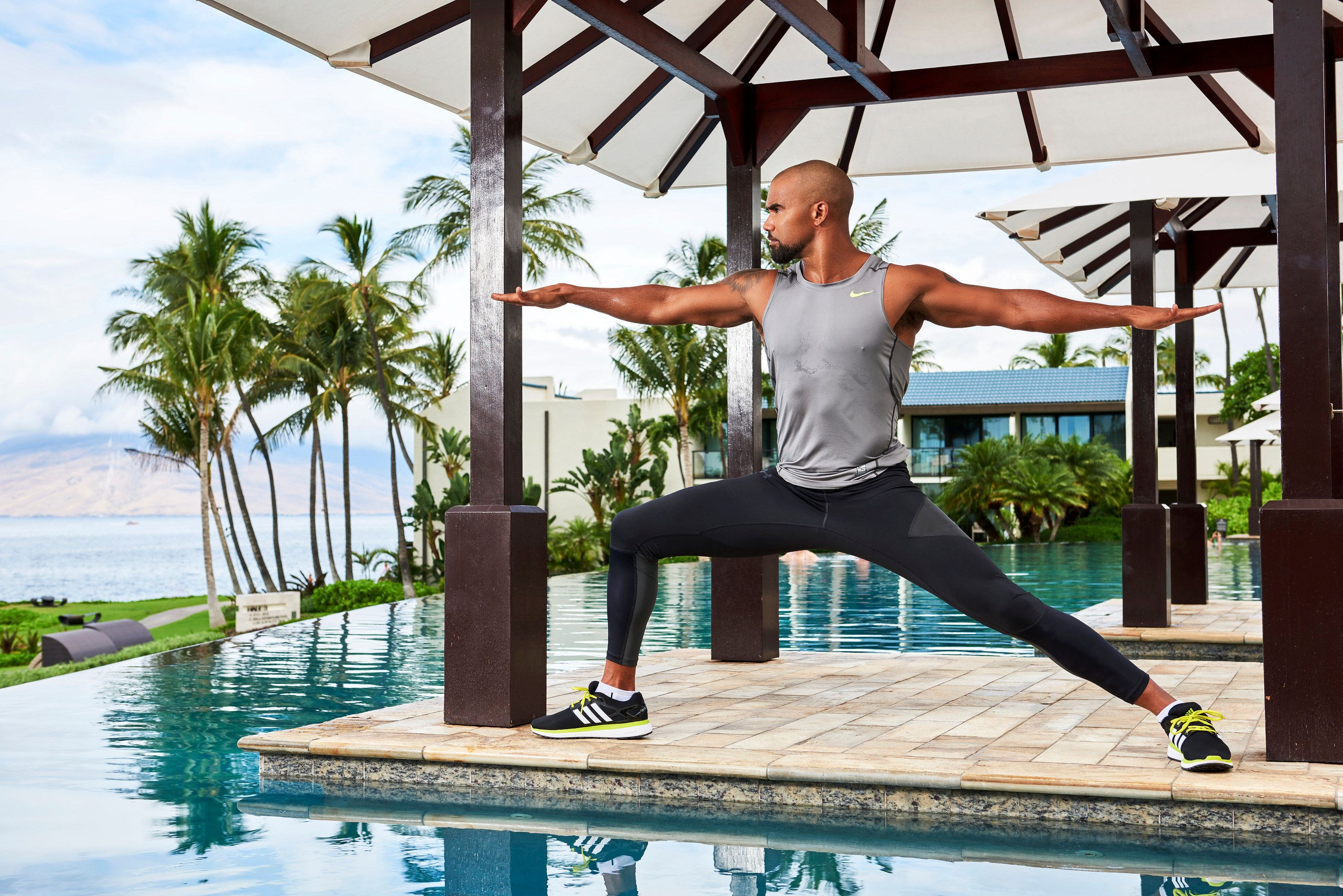 Shemar Moore strikes the yoga warrior pose as he stretches at a private hotel pool