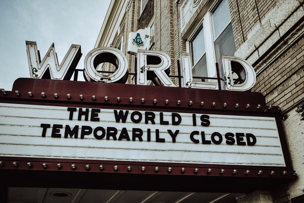 "sign that says ""The world is temporarily closed"""