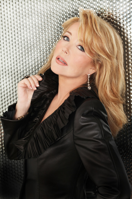 Melody Thomas Scott in a black top