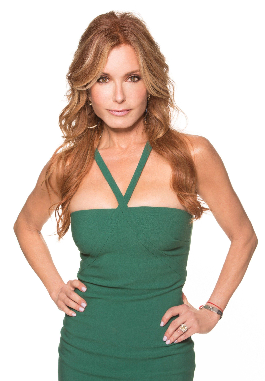 Tracey Bregman wearing a green dress