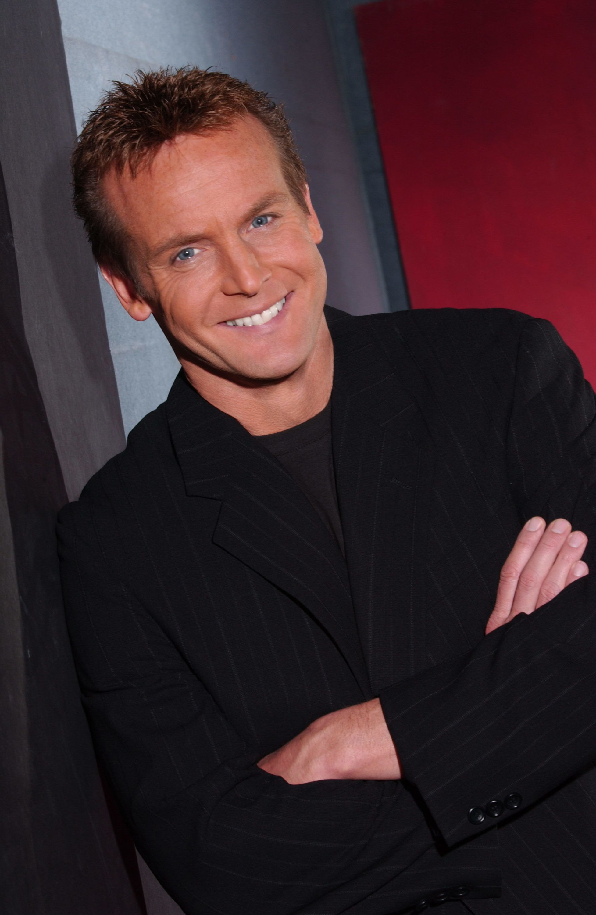 Doug Davidson crossing his arms in a suit