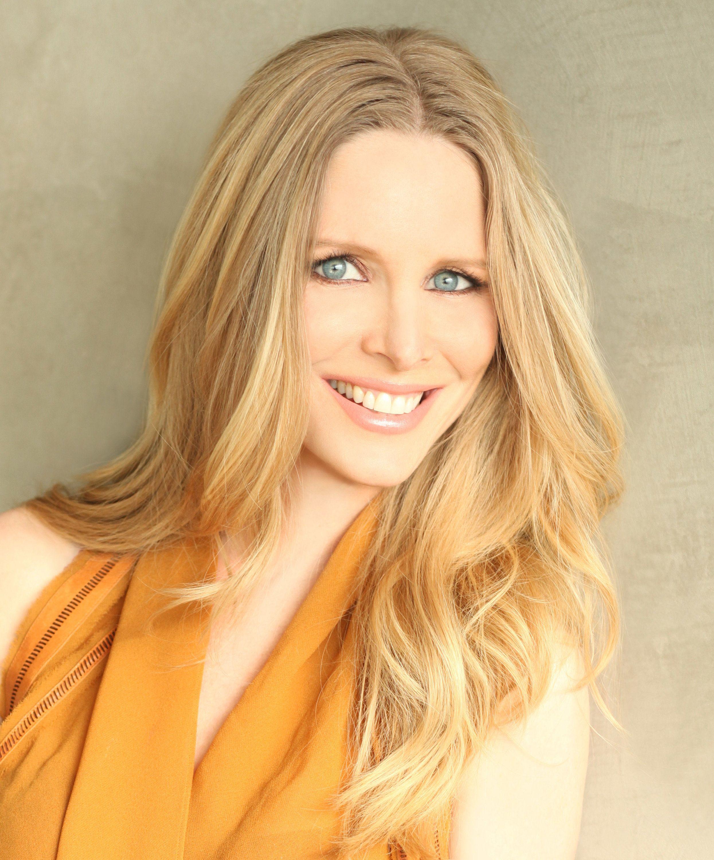 Lauralee Bell in an orange top